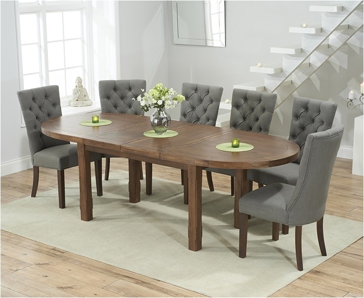 mark harris cheyenne solid dark oak dining table oval extending with 4 albury grey chairs