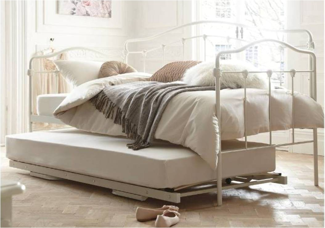 vintage iron bed with pop up trundle placed on wooden floor with upbed plus outside daybeds
