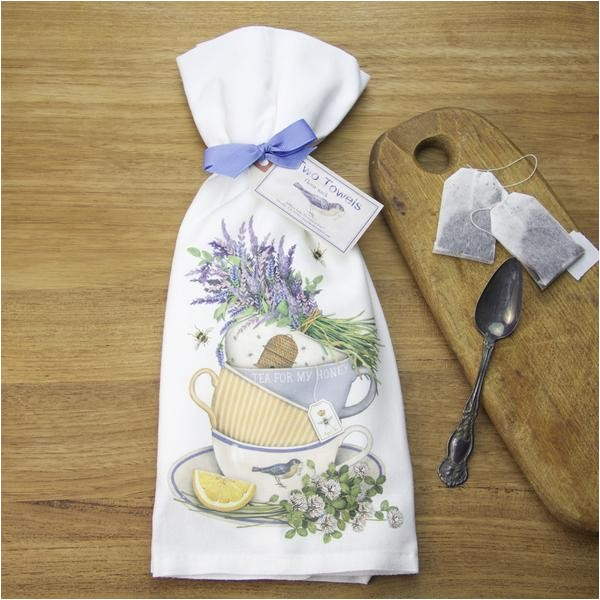 stacked teacups with lavender flour sack towels by mary lake thompson