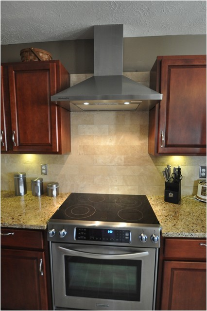 new venetian gold granite countertop with tile backsplash contemporary kitchen indianapolis