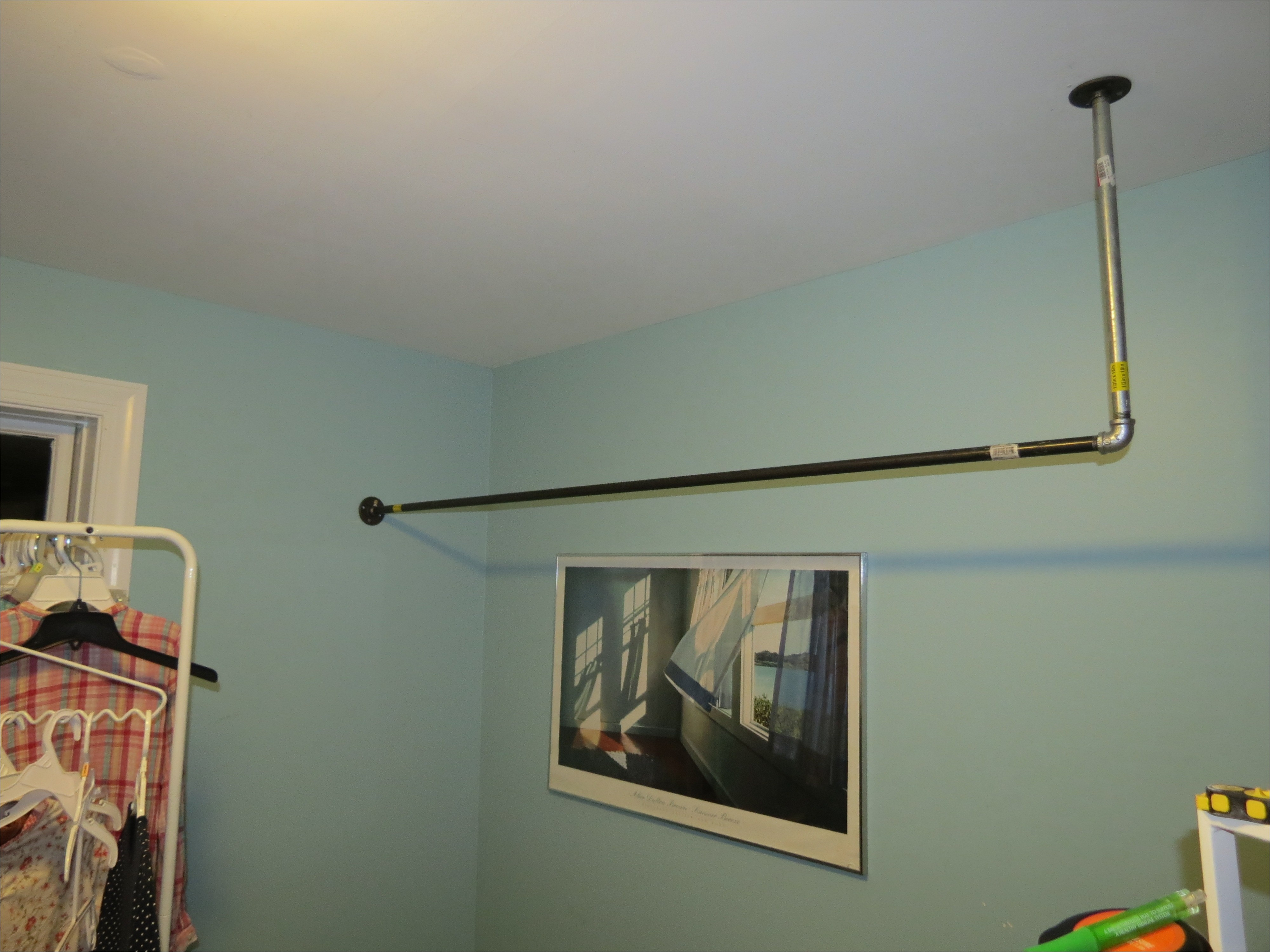 hanging closet rod from sloped ceiling