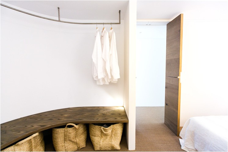 how to hang a closet rod from the ceiling hanging clothes rack wall mounted closet rod master closet