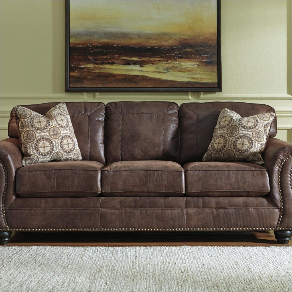 faux leather sofa with rolled arms and nailhead trimbenchcraft