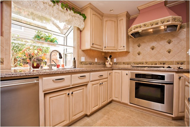 wine themed kitchen with wine cooler and grape tile details traditional kitchen san francisco