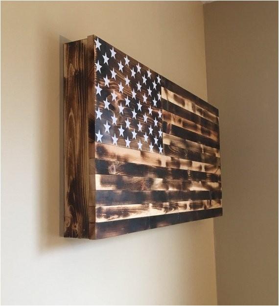 burnt american wooden flag hidden gun