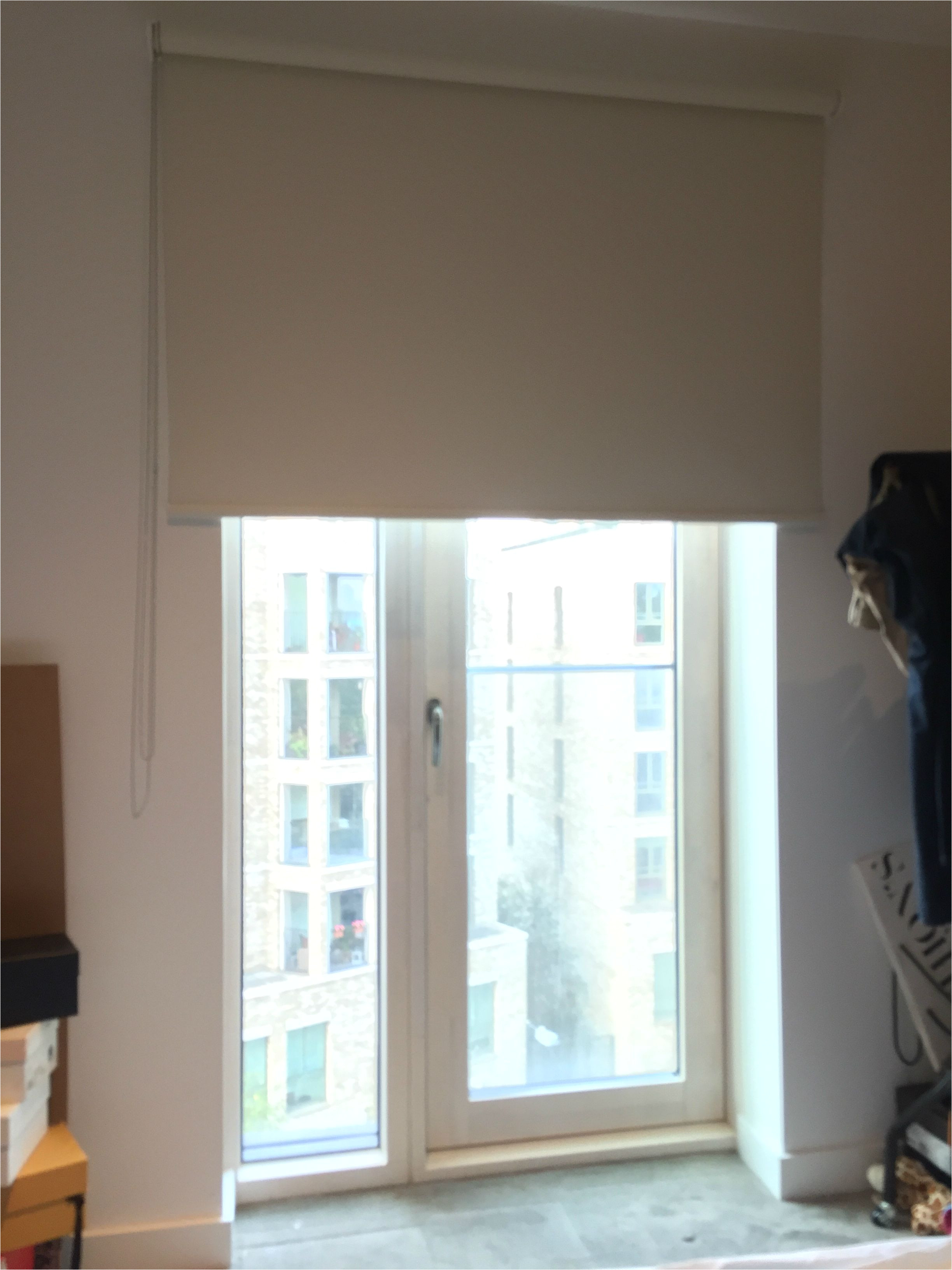Motorized Blackout Shades with Side Channels Blackout Roller Blind Fitted to French Door to Apartment In Elephant