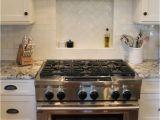 Alaska White Granite with Antique White Cabinets Granite White Alaska Delicatus Cabinets Brookhaven In