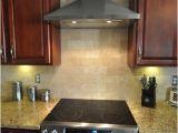 New Venetian Gold Granite and Tile Backsplash New Venetian Gold Granite Countertop with Tile Backsplash