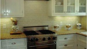 New Venetian Gold Granite with Subway Tile Backsplash New Venetian Gold Design White Subway Tile Backsplash