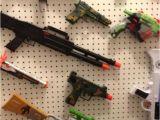 Pegboard for Nerf Guns Nerf Gun Wall Pegboard and Hooks organize Pinterest