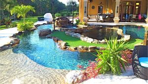 Pools with Blue Surf Pebble Sheen Backyard Oasis Lazy River Pool with island Lagoon and Jacuzzi In the